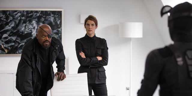 "This image released by Sony Pictures shows Samuel L. Jackson, left, and Cobie Smulders in a scene from ""Spider-Man: Far From Home."" (Jay Maidment/Columbia Pictures/Sony via AP)"