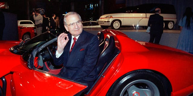 FILE - In this March 28, 1990, file photo, Chrysler Corporation Chairman Lee Iacocca sits in a 1990 Dodge Viper sports car as the Chrysler in the 90's six city tour makes a visit to New York. Former Chrysler CEO Iacocca, who became a folk hero for rescuing the company in the '80s, has died, former colleagues said Tuesday, July 2, 2019. He was 94. (Associated Press)