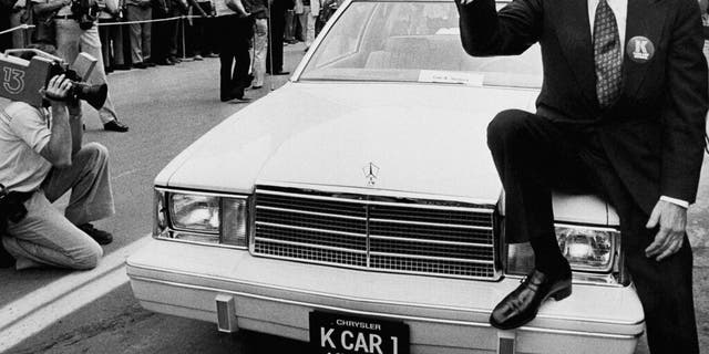 FILE - In this Aug. 7, 1980, file photo, Chrysler Corp. Chairman Lee Iacocca sits on the hood of K Car Number One, a Plymouth Reliant, in Detroit. Former Chrysler CEO Iacocca, who became a folk hero for rescuing the company in the '80s, has died, former colleagues said Tuesday, July 2, 2019. He was 94. (AP Photo/Dale Atkins, File)
