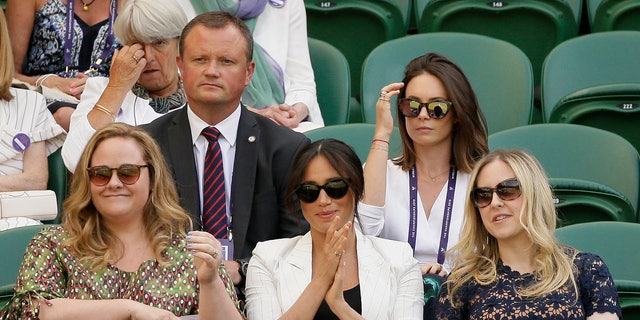 Meghan, Duchess of Sussex, center, applauds from her chair on Court Number One during day 4 of a Wimbledon Tennis Championships. (AP Photo/Tim Ireland)
