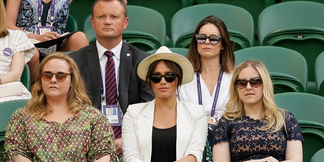 The Duchess of Sussex watches Serena Williams play Kaja Juvan in a singles compare during day 4 of a Wimbledon Tennis Championships. (AP Photo/Tim Ireland)