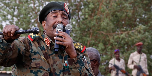 "FILE - In this June 29, 2019, file photo, Sudanese Gen. Abdel-Fattah Burhan, head of the military council, speaks during a military-backed rally, in Omdurman district, west of Khartoum, Sudan. An African Union envoy says Sudan's ruling military council and the country's pro-democracy movement have reached a power-sharing agreement, including a timetable for a transition to civilian rule. Mohammed el-Hassan Labat said early Friday, July 5, that both sides agreed to form a joint sovereign council that will rule the country for ""three years or a little more."" The sides agreed to five seats for the military and five for civilians with an additional seat going to a civilian with military background.(AP Photo/Hussein Malla, File)"