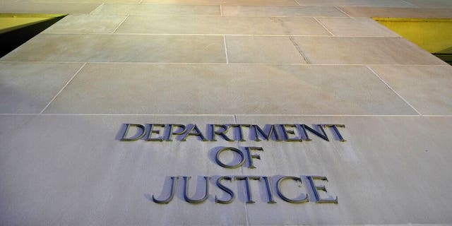 FILE: The Department of Justice domicile building in Washington early in a morning.