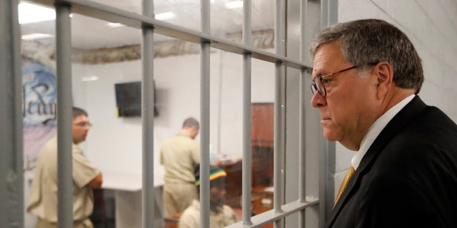 Attorney General William Barr watching inmates working in a computer class during a tour of a federal prison Monday in Edgefield, S.C. (AP Photo/John Bazemore)