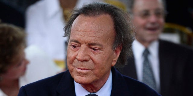 In this Sept. 29, 2016 file photo, Spanish singer Julio Iglesias attends his star unveiling ceremony at the Walk of Fame, in San Juan, Puerto Rico. A judge concluded on Wednesday, July 10, 2019 that there are enough indications to conclude that a 43-year-old Spaniard is the biological son of Iglesias, who for years has refused to undergo genetic testing to confirm paternity.