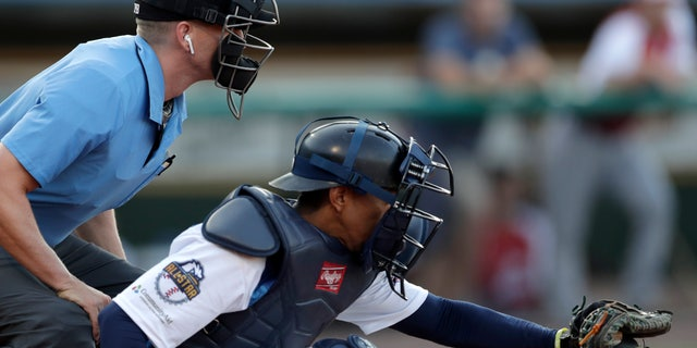 Home plate umpire Brian deBrauwere left wearing an earpiece during the first inning of the Atlantic League All Star Game last Wednesday in York Pennsylvania