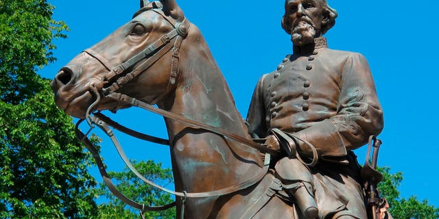FILE - In this Aug. 18, 2017, file photo, a statue of Confederate Gen. Nathan Bedford Forrest sits in a park in Memphis, Tenn.