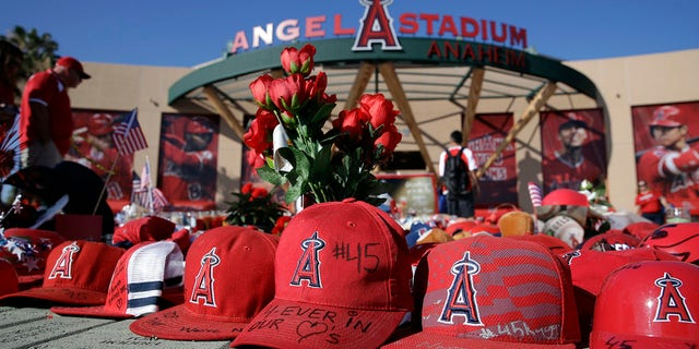A makeshift shrine in honor of Los Angeles Angels pitcher Tyler Skaggs stands outside Angel Stadium before the team's baseball game against the Seattle Mariners on Friday, July 12, 2019, in Anaheim, Calif. (Associated Press)