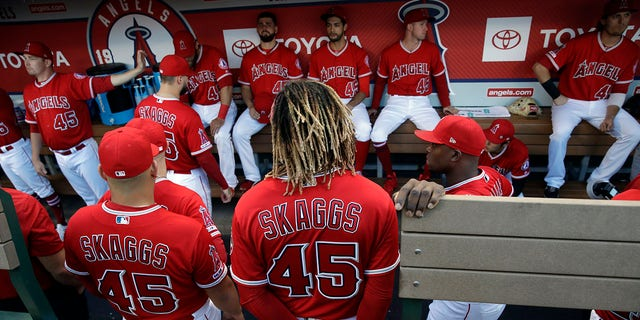Members of a Los Angeles Angels wear No. 45 in respect of teammate Tyler Skaggs, who died progressing this month, during a team's ball diversion opposite a Seattle Mariners on Friday, Jul 12, 2019, in Anaheim, Calif. (Associated Press)