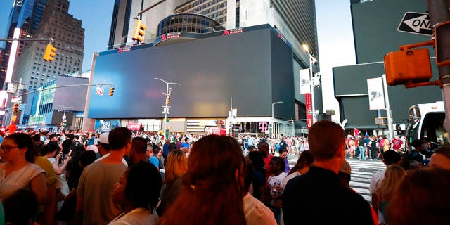 Screens in Times Square are black during a widespread power outage on July 13 in Manhattan.