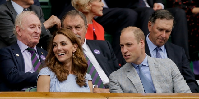 Prince William and Kate, Duchess of Cambridge sit in the Royal Box to watch the men's singles final match of the Wimbledon Tennis Championships in London, Sunday, July 14, 2019. (AP Photo/Tim Ireland)