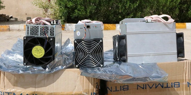 "This undated photo provided by the Police News Agency, shows boxes of machinery used in Bitcoin ""mining"" operations that were confiscated by police in Nazarabad, Iran. Squeezed by sanctions and fueled by subsidized electricity, Iranians and others lured to the country increasingly are turning to Bitcoin and other digital cryptocurrencies. (News.police.ir via AP)"