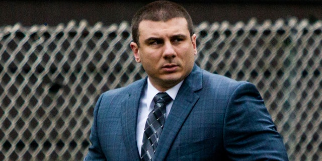 """FILE - In this May 13, 2019, file photo, New York City police officer Daniel Pantaleo leaves his house in Staten Island, N.Y. Time is running out for federal prosecutors to take action in the 2014 death of Eric Garner, the unarmed black man heard on video crying """"I can't breathe"""" after Pantaleo put him in an apparent chokehold. (AP Photo/Eduardo Munoz Alvarez, File)"""