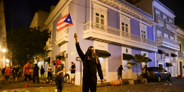 Citizens riot near the executive mansion demanding the resignation of Gov. Ricardo Rossello on Monday. (AP Photo/Carlos Giusti)