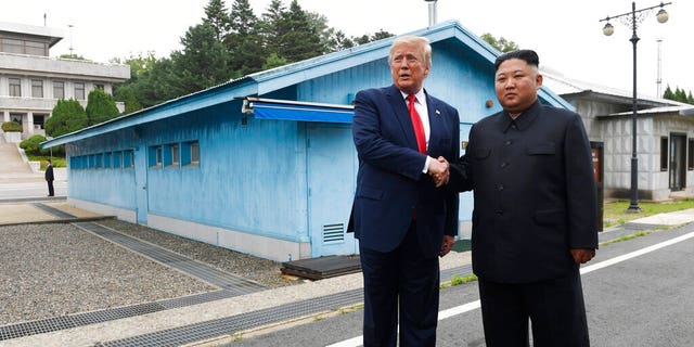 In this June 30, 2019, file photo, President Donald Trump, left, meets with North Korean leader Kim Jong Un at the border village of Panmunjom in the Demilitarized Zone, South Korea.