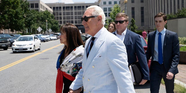 Roger Stone, a longtime confidant of President Donald Trump, accompanied by his wife, Nydia Stone, leaves federal court in Washington, Tuesday, July 16, 2019. (Associated Press)
