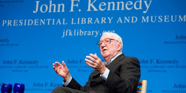 Retired U.S. Supreme Court Justice John Paul Stevens talking about his views and career during a forum at the John F. Kennedy Library in Boston, in 2013. (AP Photo/Michael Dwyer, File)