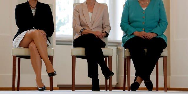From right, German Chancellor Angela Merkel, new elected European Commission President Ursula von der Leyen and Annegret Kramp-Karrenbauer, von der Leyen's successor as German Defense Minister, attend an office over ceremony at the Bellevue Palace in Berlin, Germany, Wednesday, July 17, 2019.
