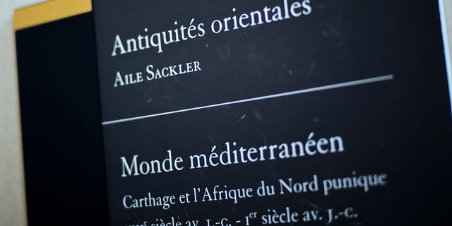 "A sign reads ""Oriental Antiquities, Sackler wing"" at the Louvre Museum in Paris, France, Wednesday, July 17, 2019. France's Louvre museum has taped over the Sackler name as donors to a wing of the building after protests against the family blamed for the opioid crisis in the United States. (AP Photo/Kamil Zihnioglu)"