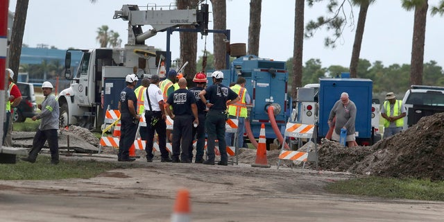 Fort Lauderdale fire rescue work the scene of a water main break near the Fort Lauderdale Executive Airport Thursday, July 18, 2019. (Carline Jean/South Florida Sun-Sentinel via AP)