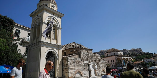 The bell tower of Pantanassa church at the Monastiraki square is damaged following an earthquake in Athens, Friday, July 19, 2019. The Athens Institute of Geodynamics gave the earthquake a preliminary magnitude of 5.1 but the U.S. Geological Survey gave it a preliminary magnitude of 5.3. The Athens Institute says the quake struck at 2:38 p.m. local time (1113 GMT) about 26 kilometers (13.7 miles) north of Athens. (AP Photo/Petros Giannakouris)