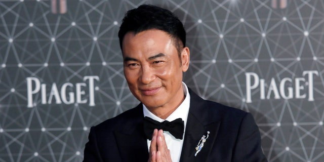 Simon Yam poses on the red carpet of the Hong Kong Film Awards in Hong Kong, April 3, 2016. (Associated Press)