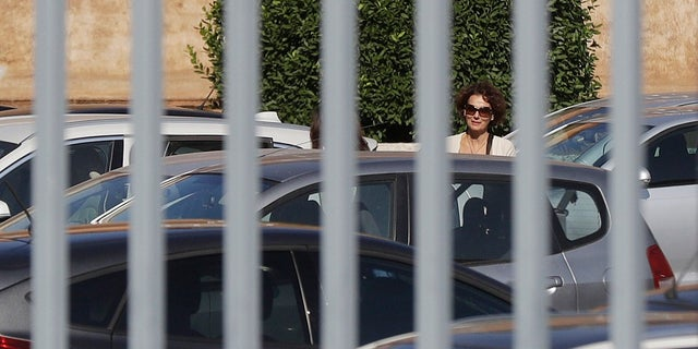 Federica Orlandi , sister of Emanuela Orlandi who went missing in 1983, is seen trough the bars of a gate as she arrives at the Vatican on Saturday. (AP Photo/Gregorio Borgia)
