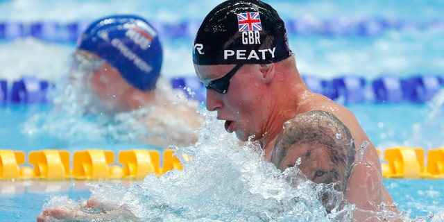 Britain's Adam Peaty swims in his heat of the men's 100m breaststroke at the World Swimming Championships in Gwangju, South Korea on Sunday. (AP Photo/Lee Jin-man)