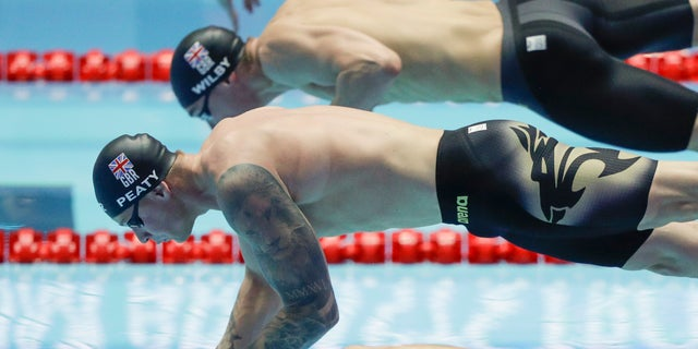 Britain's Adam Peaty starts in the men's 100m breaststroke semifinal at the World Swimming Championships in Gwangju, South Korea on Sunday. (AP Photo/Mark Schiefelbein)