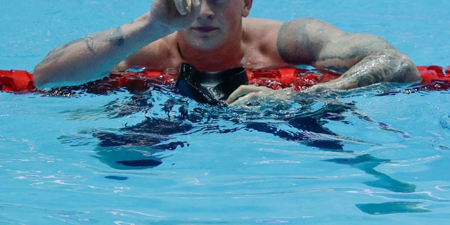 Britain's Adam Peaty gestures after his men's 100m breaststroke semifinal at the World Swimming Championships in Gwangju, South Korea on Sunday. (AP Photo/Mark Schiefelbein)