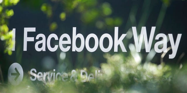 FILE: An address sign for Facebook Way is shown in Menlo Park, Calif.