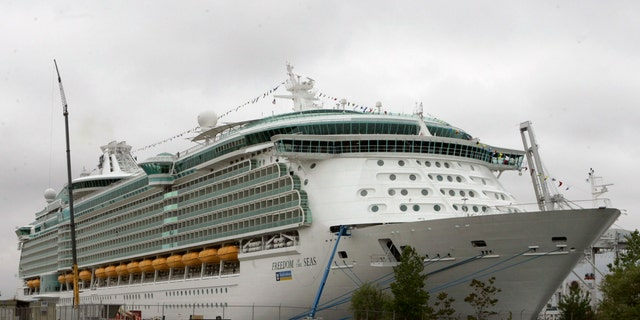 """This file photo photo shows the Freedom of the Seas cruise ship docked in New Jersey. Kimberley Wiegand, the mother of an 18-month-old Indiana girl who fell to her death from an open window on the cruise ship in Puerto Rico, told NBC's """"Today"""" show Monday, July 22, 2019 that her family will sue Royal Caribbean Cruises for """"not having a safer situation on the 11th floor of that cruise ship."""" (AP Photo/Mike Derer, File)"""