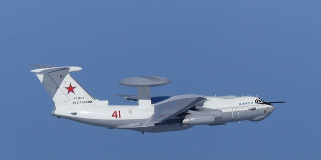This image released by Joint Staff, Ministry of Defense, shows Russian A-50 airborne early warning and control aircraft flying near the Korean-controlled island called Takeshima in Japanese Tuesday, July 23, 2019. Japan has protested to Russia for allegedly violating Japanese airspace and to South Korea for firing warning shots there. (Joint Staff, Ministry of Defense via AP)