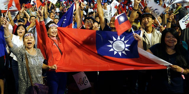 2018, file photo, supporters of the opposition Nationalist Party cheer in Kaohsiung, Taiwan. (AP Photo / File)