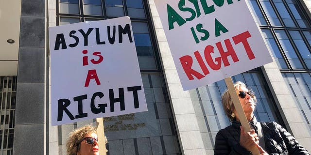 "Protestors holding signs that read ""Asylum is a Right"" outside of the San Francisco Federal Courthouse on Wednesday."