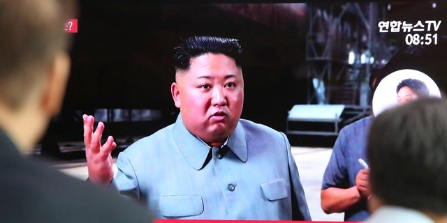 People watching a TV showing a file image of North Korean leader Kim Jong Un during a news program at the Seoul Railway Station in Seoul, South Korea, Thursday. (AP Photo/Ahn Young-joon)