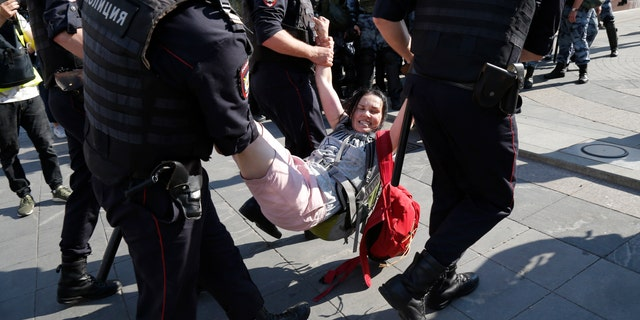 Russian police are wrestling with demonstrators and have arrested hundreds in central Moscow during a protest demanding that opposition candidates be allowed to run for the Moscow city council. (AP Photo/Alexander Zemlianichenko)
