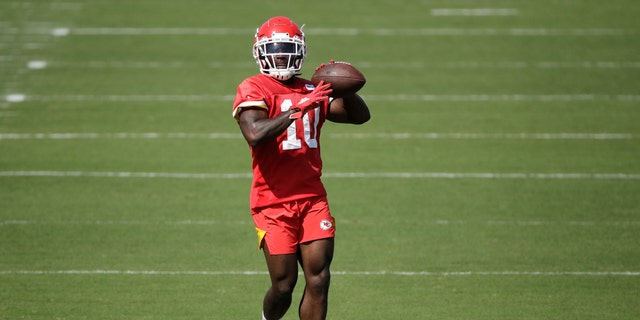 Kansas City Chiefs wide receiver Tyreek Hill throwing the ball during NFL football training camp Saturday. (AP Photo/Charlie Riedel)