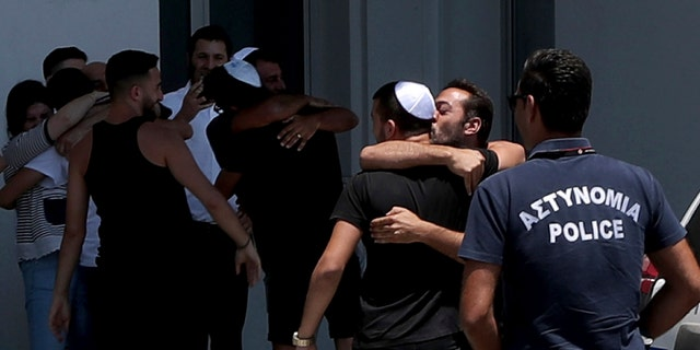 An Israeli teenager is embraced by relatives after being released from Famagusta police headquarters in southeast town of Paralimni, Cyprus, on Sunday. (AP Photo/Petros Karadjias)