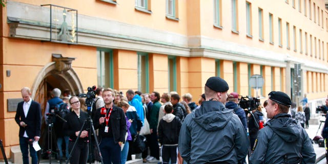 Journalists wait outside the district court where American rapper A$AP Rocky is to appear on charges of assault in Stockholm, Sweden, on Tuesday.