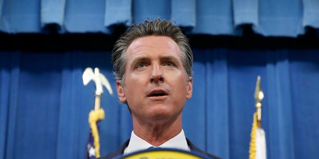 California Gov. Gavin Newsom during a news conference in Sacramento, Calif. Newsom signed a law Tuesday, July 30, requiring presidential candidates to release their tax returns to appear on the state's primary ballot, a move aimed squarely at Republican President Donald Trump. (AP Photo/Rich Pedroncelli)