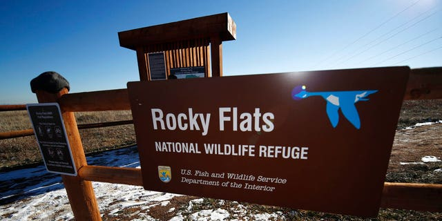 A sign marks a trailhead at the Rocky Flats National Wildlife Refuge in Broomfield, Colo., outside Denver.