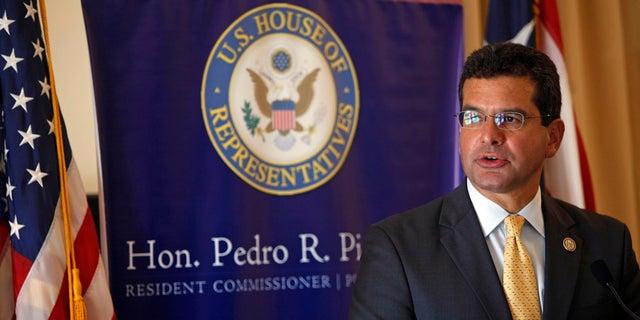 In this Sept. 24, 2013, photo, Pedro Pierluisi, Puerto Rico's representative in Congress, speaks during a conference in San Juan, Puerto Rico. (AP Photo/Ricardo Arduengo, File)