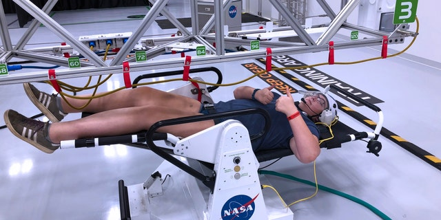 Microgravity space walk during the astronaut training experience at Kennedy Space Center. (Photo by Dave Parfitt)