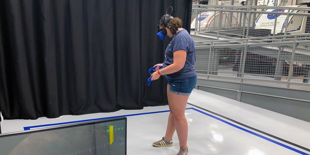 Virtual Reality walk on Mars during the astronaut training experience at Kennedy Space Center. (Photo by Dave Parfitt)