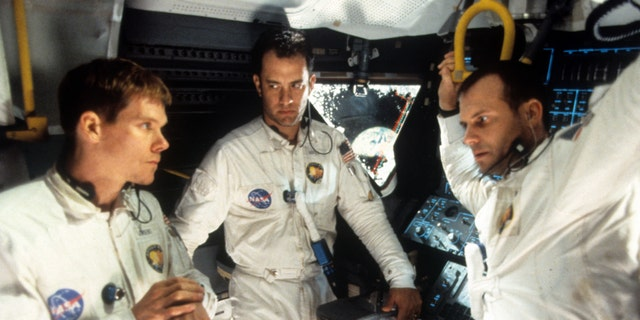 Kevin Bacon, Tom Hanks, and Bill Paxton, who portrayed Fred Haise, talking in ship in a scene from the film 'Apollo 13', 1995.