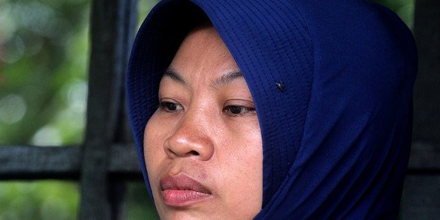 Baiq Nuril Maknun, who exposed her cheating boss, looks stunned after she got slapped with a six-month jail term for violating a controversial law against spreading indecent material, in Mataram on Lombok island on November 16, 2018. - The supreme court's shock decision overturned an earlier court ruling that cleared the woman of breaking the controversial law against spreading indecent material. (Photo by Pikong / AFP) (Photo credit should read PIKONG/AFP/Getty Images)