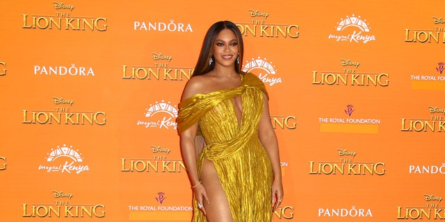 Singer Beyonce poses for photographers upon arrival at the 'Lion King' European premiere in central London, Sunday, July 14, 2019. Her original song for the film failed to score on Oscars nom.