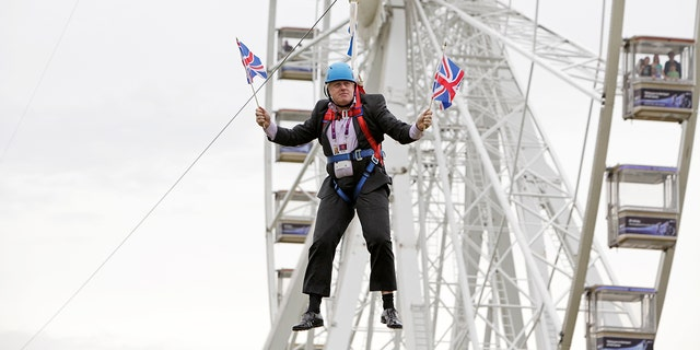 Mayor of London Boris Johnson got stuck on a zip-line during BT London Live in Victoria Park on August 01, 2012 in London, England.