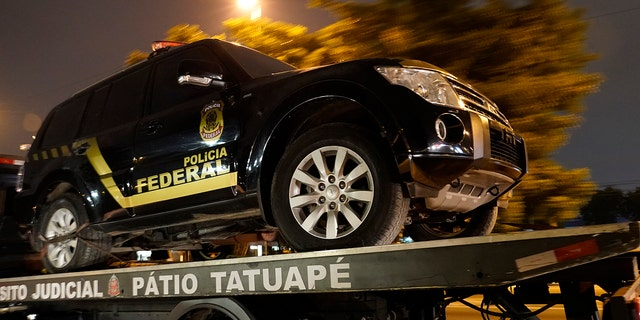 A fake police truck that was used in robbery is transported on a flat-bed truck in Sao Paulo, Brazil, Thursday, July 25, 2019. (AP Photo/Victor R. Caivano)